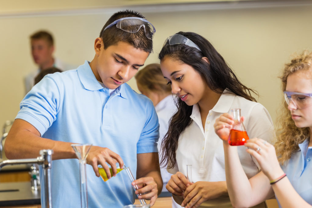 Students working together in high school chemistry class